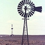 A gas rig and windmill in Sublette County. (Michael Smith/Newsmakers/Getty)